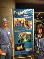 Team members Kevin Parsons and Priya Patil with one of the posters created for the competition's exhibit