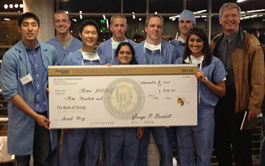 Dr. Puskas and the BME team accepting the 2nd prize check