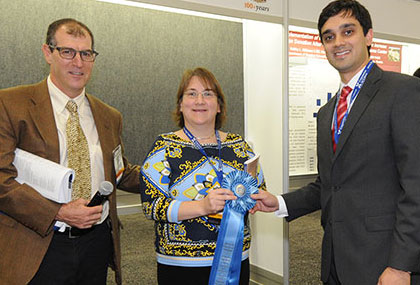 Dr. Sancheti receives the Best Poster award from Craig Derkay, MD, vice-chair of the ACS 2014 Meeting Program Committee, and Audra Duncan, MD, executive member of the committee.